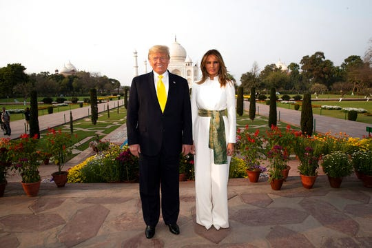 President Donald Trump, with first lady Melania Trump, pause as they tour the Taj Mahal, Monday, Feb. 24, 2020, in Agra, India.