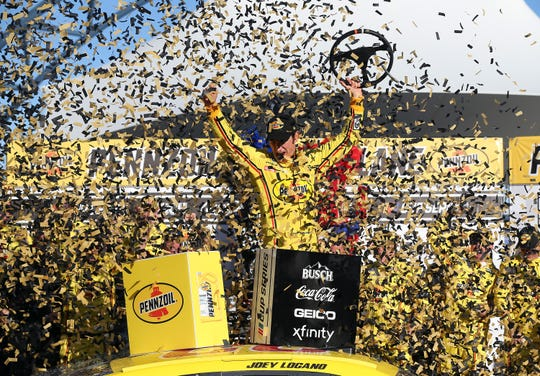 Joey Logano, driver of the No. 22 Ford, celebrates in Victory Lane after winning the NASCAR Cup Series Pennzoil 400 on Sunday at Las Vegas Motor Speedway