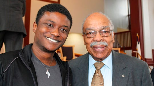 J Kobe Kelley-Mills, a junior at Benedict College, and civil rights activist James L. Felder, pose for a photo after a workshop on African Americans and the vote held at Benedict College, a historically black college in Columbia, S.C., on Tuesday, Feb. 18, 2020.
