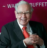 In this May 5, 2019, file photo Warren Buffett, Chairman and CEO of Berkshire Hathaway, smiles as he plays bridge following the annual Berkshire Hathaway shareholders meeting in Omaha, Neb. Berkshire Hathaway Inc. reports earnings on Saturday, Feb. 22, 2020.