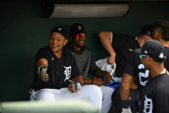 Miguel Cabrera jokes with teammates in the dugout during the Tigers' game against the Astros on Monday.