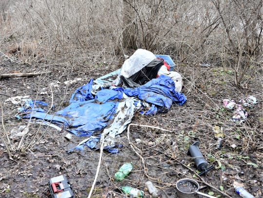 A third abandoned homeless tent camp cluttered with trash and debris turned up along the Chemung River in Elmira.