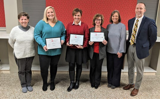 Beth Benko, President, Port Clinton Board of Education with Flagship Award recipients Abbie Fox, First Mate Award; Kendra Van Doren, Captain Award; Gaye Winterfield, Crew Award; with Michele Mueller, Vice President; and Superintendent of Schools Patrick Adkins.