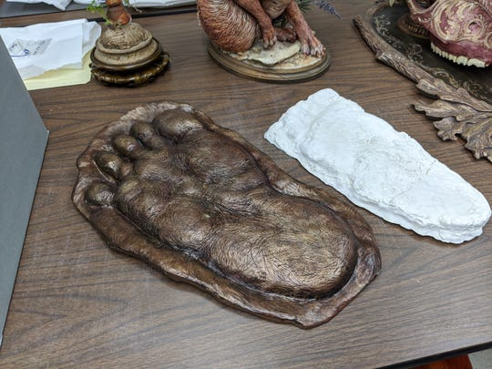 "Artist Dan Chudzinski made this Bigfoot footprint, left, that will be displayed with a mold from a print taken in Cuyahoga National Park on the right during ""Ohio: An Unnatural History"" exhibit opening Friday."