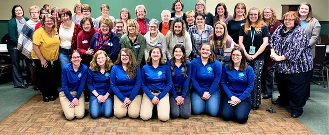 Members of the Clyde High School Teen Leadership Class, in front, spoke to the Clyde Career Women at its Feb. 10 meeting. During the meeting, four new members were inducted into the group.