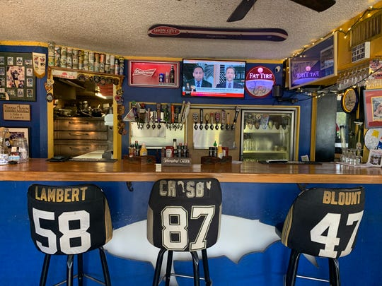 Great White has limited bar seating. Its stools are covered in pro-sports jerseys.