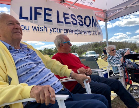 Joe Trapani, 87, Michael Jacino, 92, and Nan Read, 89, were three of the seniors from American House in Fort Myers offering free life advice at the farmer's market at Fenway South on Monday, Feb. 24, 2020.
