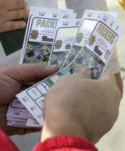 Tickets for a  Green Bay Packers home game.