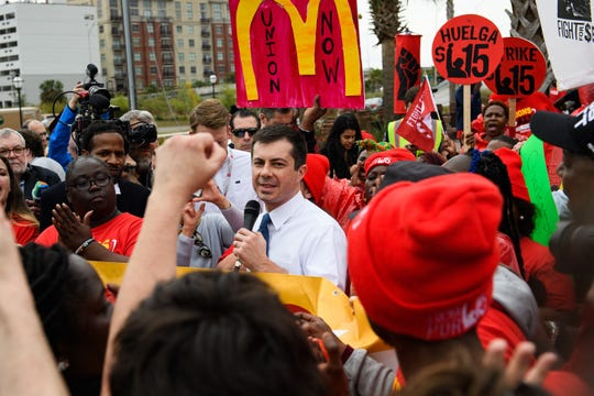 Democratic presidential candidate Pete Buttigieg speaks during a Fight for 15 protest at a McDonald's in Charleston Monday, Feb. 24, 2020.