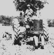 One of the three brothers' workmen drives his tractor through land that would become, a decade later, the site of First Baptist Church.