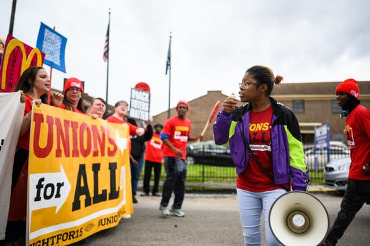 Protestors march during a Fight for 15 demonstration at a McDonald's in Charleston Monday, Feb. 24, 2020.