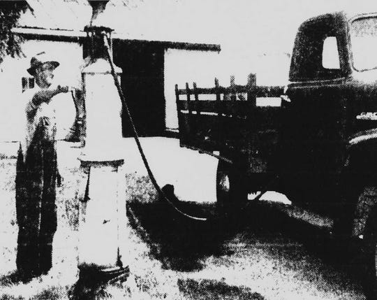 In 1957, The Greenville News featured the Schwiers brothers and their farms in a major story. Here, Bill Schwiers pumps gas into one of his fleet of trucks after his 5 a.m. downtown deliveries.