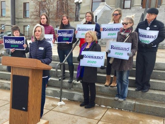 Melissa Romano, Democratic candidate for state superintendent of public instruction, holds an  Education Week rally Monday in front of the state Capitol.