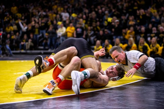 Iowa's Pat Lugo wrestles Oklahoma State's Boo Lewallen at 149 pounds during the Hawkeye's last home dual of the season, on Sunday, Feb. 23, 2020, in Carver Hawkeye Arena.
