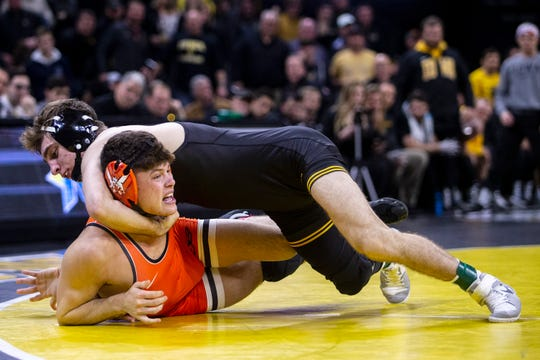 Iowa's Austin DeSanto wrestles Oklahoma State's Reece Witcraft at 133 pounds during the Hawkeye's last home dual of the season, on Sunday, Feb. 23, 2020, in Carver Hawkeye Arena.