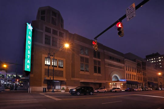The lighted sign on the new IndyStar office building is tested on Thursday evening, Sept. 11, 2014. The Star moved from its 107-year-old building to the new offices later that month.