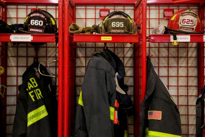 Turnout coats and helmets sit on a rack at Wabash Township Volunteer Fire Department Station 1, Monday, Feb. 24, 2020 in Wabash Township.