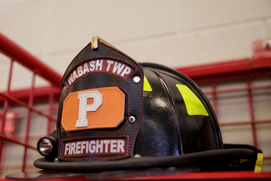 A Wabash Township Volunteer Fire Department helmet sits on a rack at Station 1, Monday, Feb. 24, 2020 in Wabash Township.