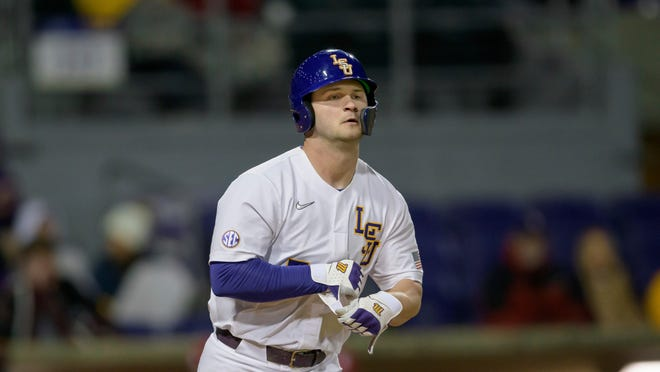 Louisiana State outfielder Drew Bianco takes his base after being walked during an NCAA baseball game against Indiana on Friday, Feb. 14, 2020, in Baton Rouge, La. (AP Photo/Matthew Hinton)