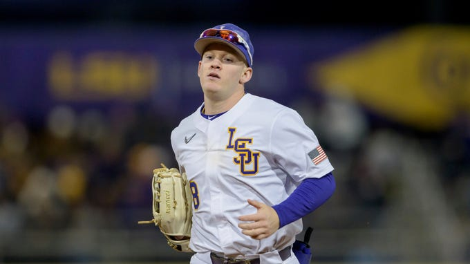 Louisiana State outfielder Daniel Cabrera runs off the field during an NCAA baseball game against Indiana on Friday, Feb. 14, 2020, in Baton Rouge, La. (AP Photo/Matthew Hinton)