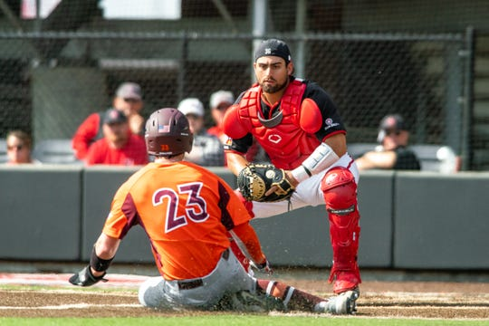 Ragin' Cajuns catcher Sebastian Toro waits to tag out a Virginia Tech runner at the plate earlier this season at The Tigue.