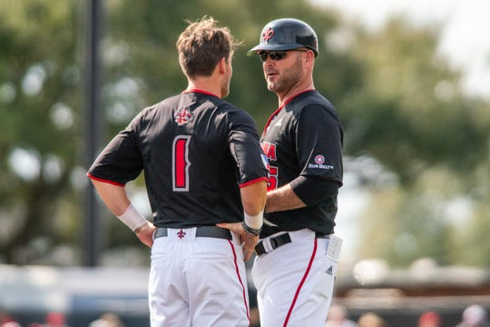 UL assistant coach Jeremy Talbot (right) talks with second baseman Connor Dupoy (1) during a game against Virginia Tech last weekend at The Tigue.