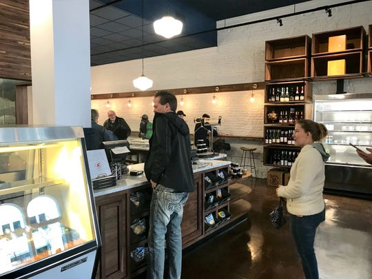Customers line up at the new Provisions Bakery & Deli at 135 W. Main St. The business was originally Four Reasons Bakery & Deli.