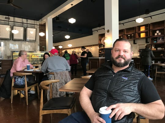 Provisions Bakery & Deli owner Matt Brady sits in his restaurant that opened Monday. He bought Four Reasons Bakery and & Deli and renovated and renamed the downtown restaurant at 135 W. Main St. It had been closed for renovation work since Dec. 24.
