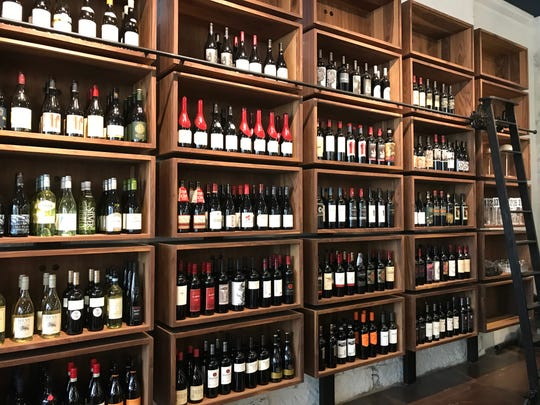 A large wine shelf is one of the highlights of Provisions Bakery & Deli at 135 W. Main St.