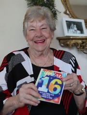 Elizabeth Goodin, 87, holds a birthday card for someone turning 16, Feb 24, 2020.  In 1956 she gave birth to a leap year baby.  Her daughter will be 64 on February 29 . . . or, technically, 16.  The wild part is that two other women who worked with her at the Louisville Yellow Pages also had babies on that day.