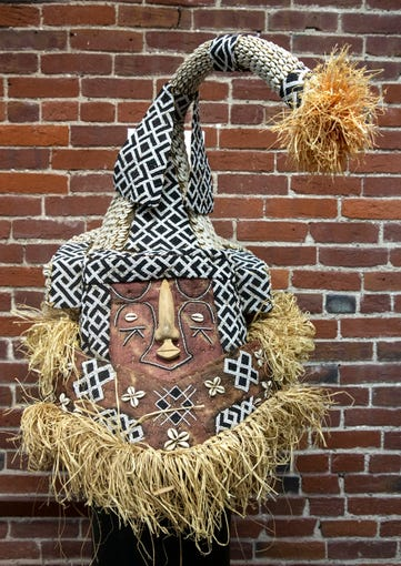 A mask of BuKuba, from African lore, thought to be like the biblical Adam. The headdress is part of an exhibit at Roots 101, an African American museum in Louisville. Feb. 22, 2020.