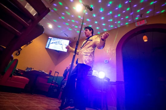 Danny Shouse Jr.,'Lil D,' performs as young Elvis at El Nopal Mexican Restaurant, in Hillview, Ky. Feb. 10, 2020