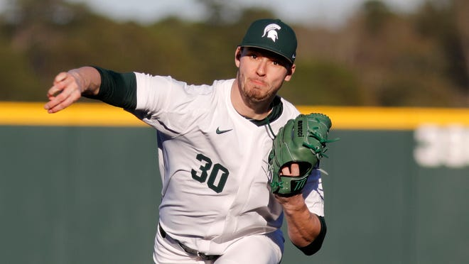 Michigan State's Mason Erla pitches the ball to a Morehead State batter in an NCAA college baseball game at Shipyard Park Friday, Feb. 14, 2020, in Mt. Pleasant, S.C. Michigan State defeated Morehead State 15-3.