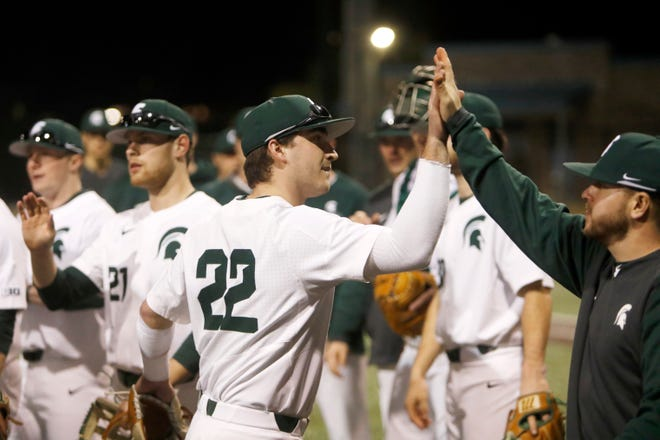 Michigan State players high five each other after defeating Morehead State in an NCAA college baseball game at Shipyard Park Friday, Feb. 14, 2020, in Mt. Pleasant, S.C. Some MSU players will be part of the Lemonade League hosted by the Lansing Lugnuts