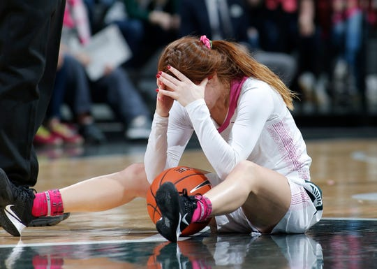 Michigan State's Taryn McCutcheon reacts after being called for a foul on a steal attempt against Michigan during the second half of an NCAA college basketball game, Sunday, Feb. 23, 2020, in East Lansing, Mich. Michigan won 65-57. (AP Photo/Al Goldis)
