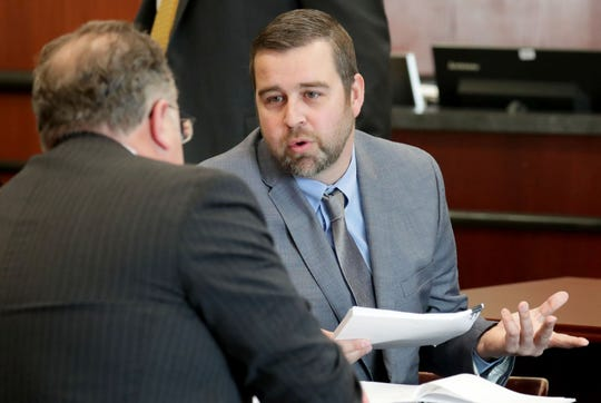 Jacob Banas, right, talks with his attorney Michael Lueder in an Ozaukee County Court in Port Washington on Monday.