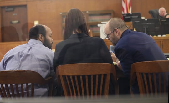 Matthew Lee Wilks, left, confers with his attorneys. The trial for Wilks, who is charged in the shooting death of Tracey Smith, began in the Milwaukee County Court of Judge Jeffrey A. Wagner with jury selection Monday.