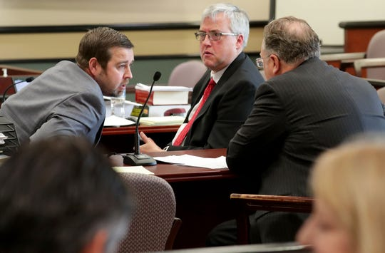Jacob Banas, left, talks with his attorneys Brent Nistler, center, and Michael Lueder in an Ozaukee County courtroom in Port Washington on Monday.