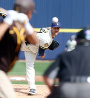 Josh Lindblom delivers a pitch during the second inning Sunday.