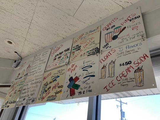 The menu at Lee's Dairy Treat is hand drawn. The restaurant features a wide variety of menu items, from sundaes and floats, to chili and Barbecue sandwiches.