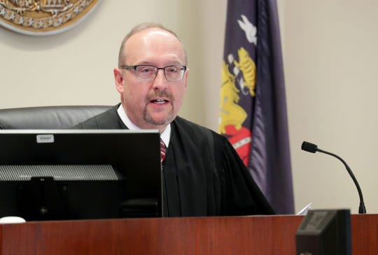 """Washington County Circuit Judge Todd Martens presides in an Ozaukee County Court in Port Washington on Monday as Jacob Banas, who was charged last year with """"administering a dangerous or stupefying drug,"""" appears in court."""