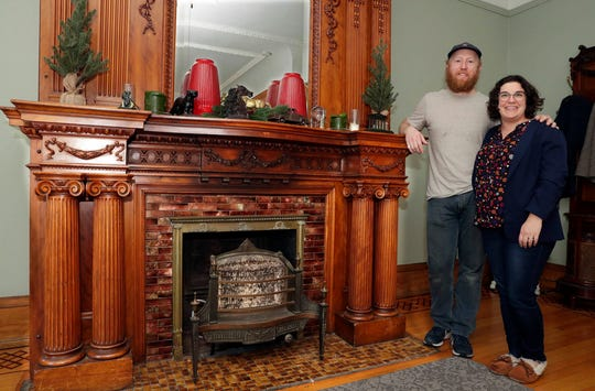 Brad and Cassia Carter admire an ornate fireplace in the living room of their historic home in the Concordia neighborhood. They use Instagram to document and connect with people who love restoring old homes in Milwaukee. Photo by Rick Wood/Milwaukee Journal Sentinel ORG XMIT: 30099901A