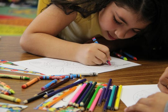 Third-grader Itzel Plata works on a coloring activity during a dual language class at Heyer Elementary School in Waukesha. The Waukesha School District offers a Dual Language Immersion Program that educates students in two languages – English and Spanish – from 4-year-old kindergarten through 11th grade.