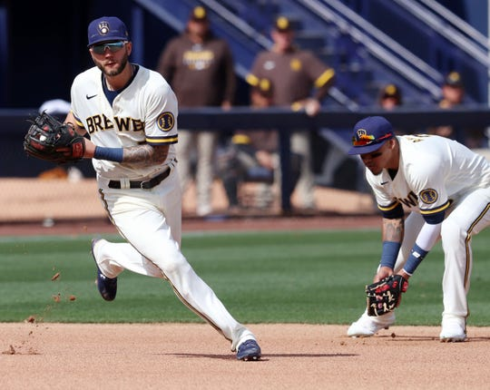 Brewers third baseman Lucas Erceg, left, fields a grounder in front of shortstop Orlando Arcia, during the third inning Sunday.