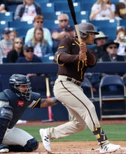 San Diego's Trent Grisham, formerly of the Brewers, hits a single during the first inning Sunday in Phoenix.