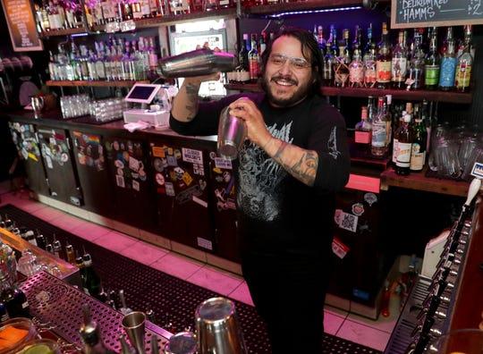 Owner Ricky Ramirez mixes a drink at The Mothership, a bar at 2301 S. Logan Ave. in Bay View.