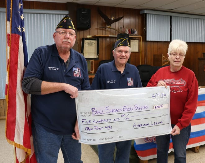 The Bull Shoals American Legion Post 431 recently donated $500 to the Bull Shoals Food Pantry.  Pictured are (from left) Rich Hartman, Legion Vice Commander; Sammy Davis, Jr., Legion Commander; and Penni Lloyd of the Bull Shoals Food Pantry.