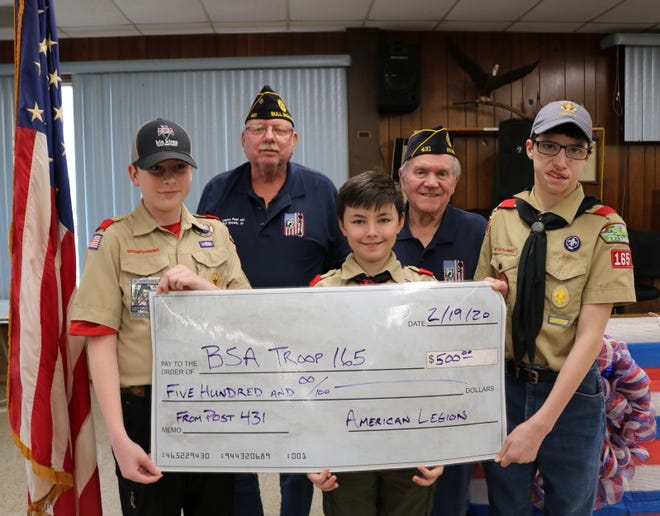 The Bull Shoals American Legion Post 431 recently donated $500 to Troop 165 of the Boy Scouts of America.  Pictured (front row) are Senior Patrol Leader Charlie Bailey, Scout Evan Franklin, and Scout Wade Strong, (back row) Legion Vice Commander Rich Hartman, and Sammy Davis, Jr., Legion Commander.