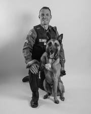 """Detective Corporal Michael McMahon poses with partner """"Kai"""" ahead of their appearance on """"America's Top Dog"""" series."""