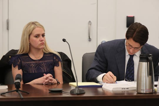 Kelsey Ketron, left, with defense attorney Trey Harwell at a hearing on Feb. 24, 2020 in which Ketron entered a no contest plea to resolve fraud charges she was facing.